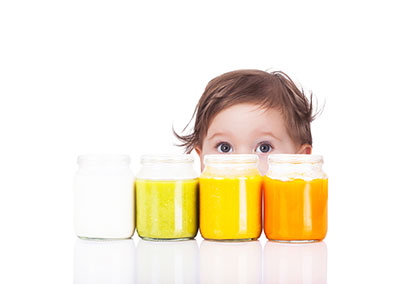 Baby with baby food