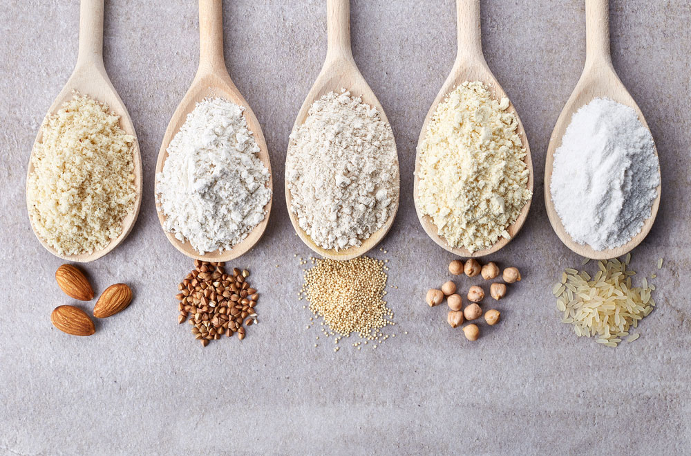 Wooden spoons of various gluten-free flour