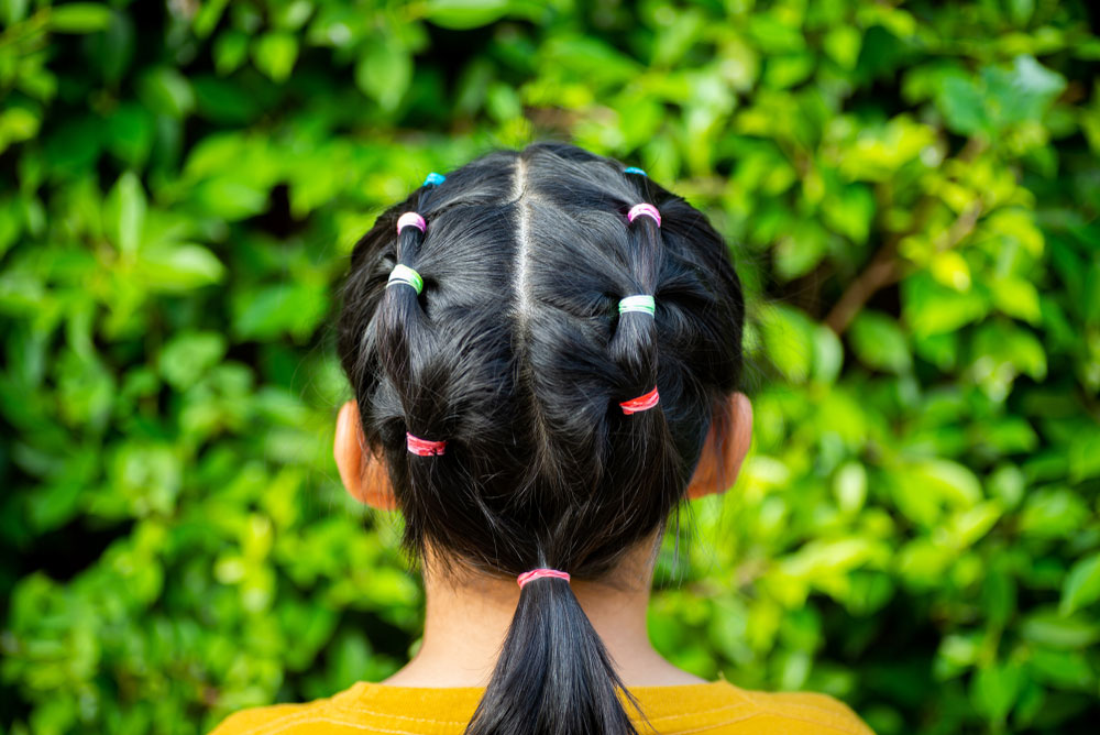 Little girl's hair styled with a baby ponytail holder