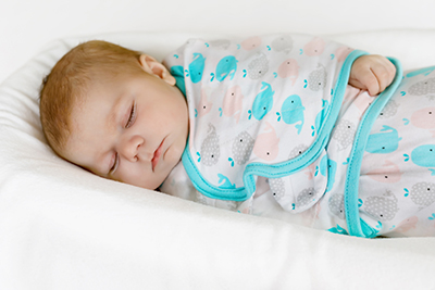 The Baby sleeping in the Baby Swaddle