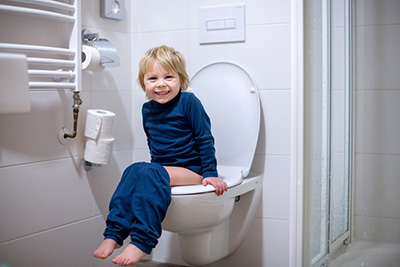 Toddler Sitting on Toilet