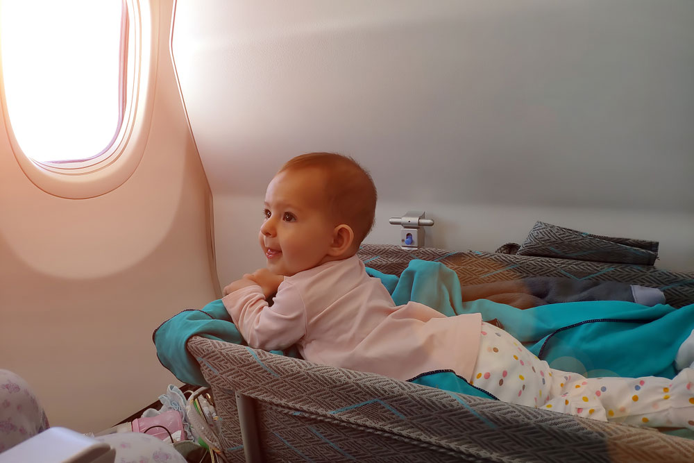 The traveling baby lay in a crib