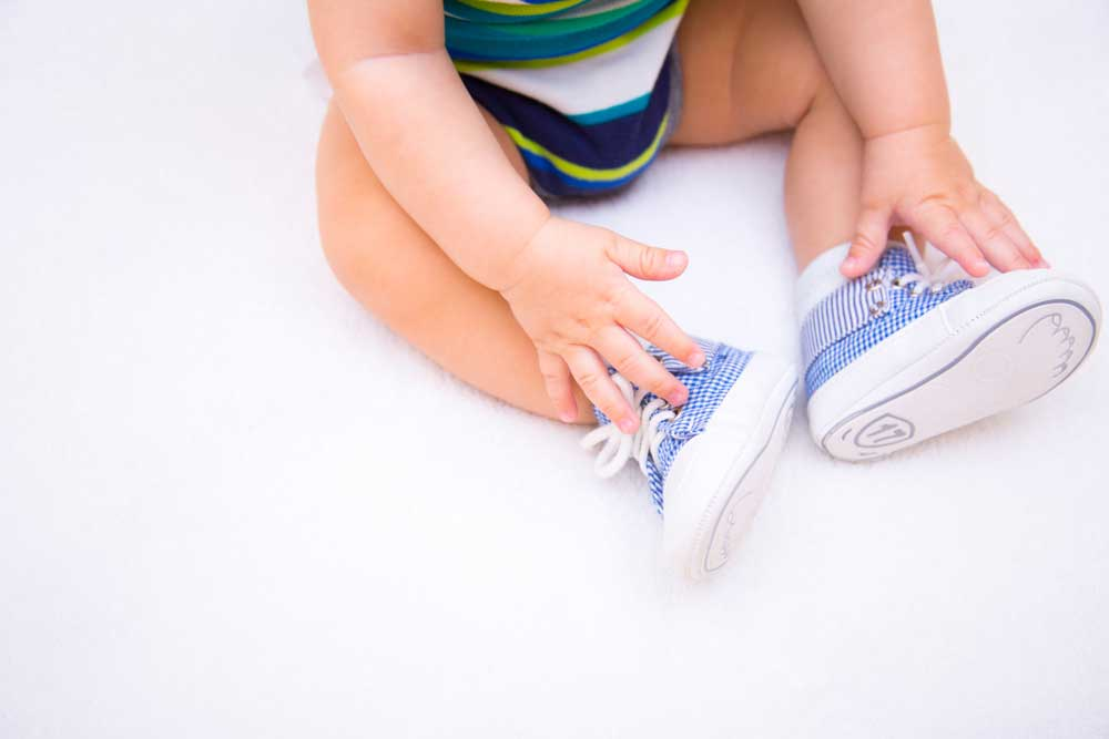 Little baby wearing a suitable shoe