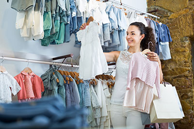 A mother purchasing baby clothes