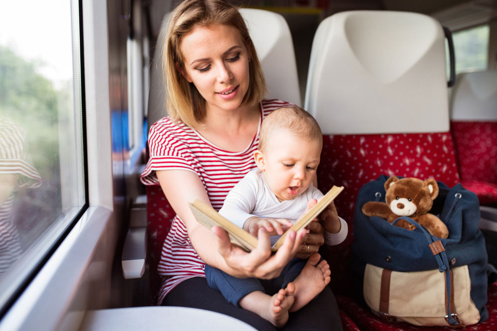 Young mother taking baby travel