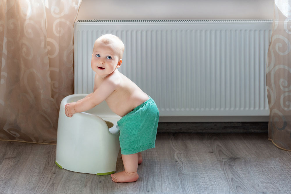 Baby Boy Playing Next to Heater