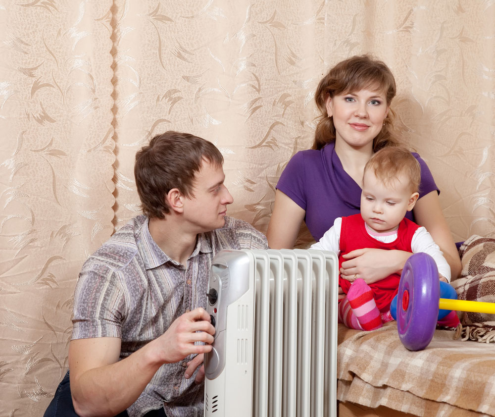 Family Relaxing Next to Heater