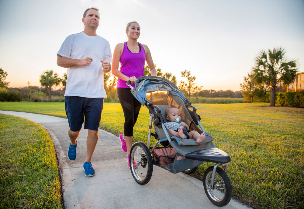 Couple Jogging with a Stroller