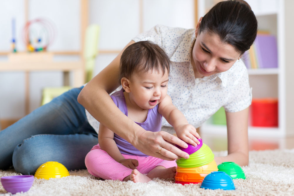 Use toys to help your baby sit up