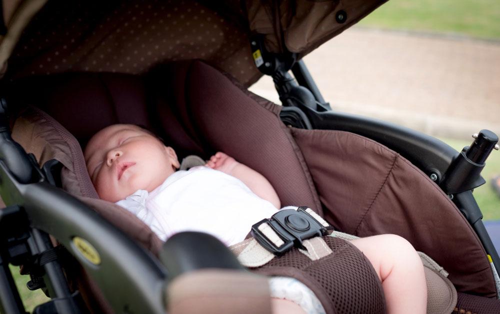 Newborn Sleeping in Stroller