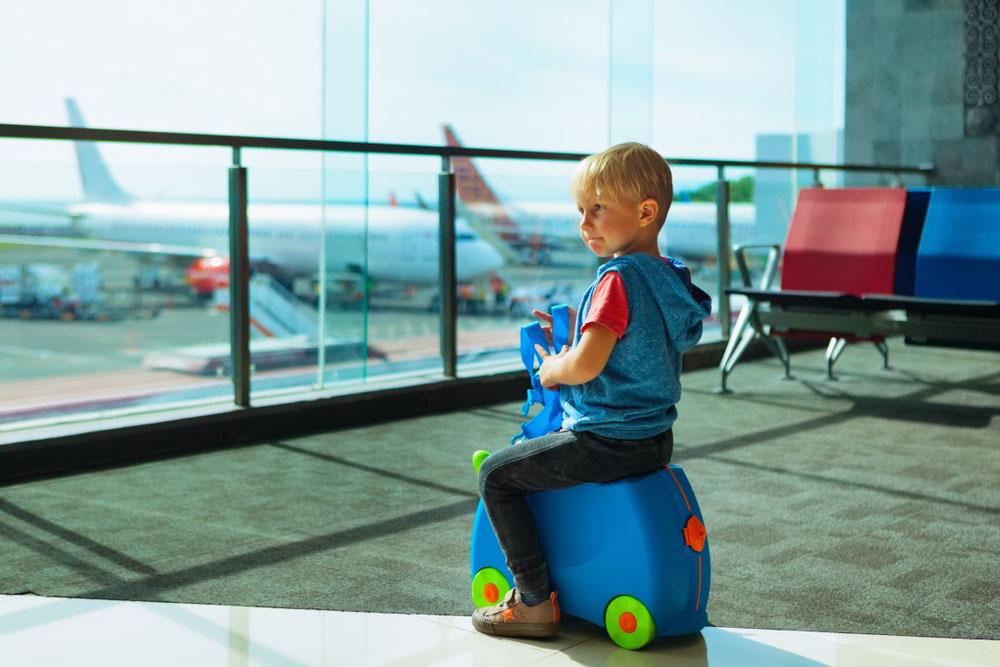 Baby rides a plane