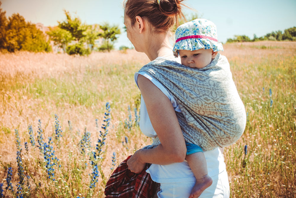 Caption: Baby wearing a hat to shield them from the sun