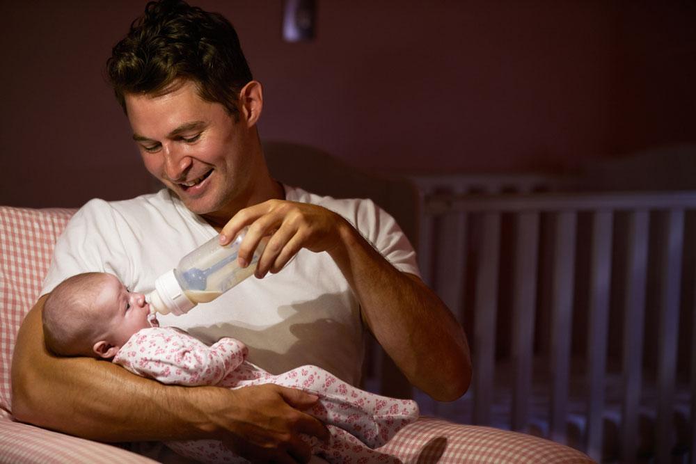 Dad is feeding baby